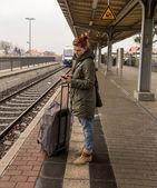 Woman on railway station — Stock Photo