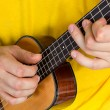 Man playing ukulele — Foto Stock