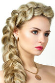 Portrait of young blonde woman with fishtail hair-dress — Stock Photo