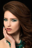 Portrait of beautiful young woman with blue nails and eye makeup — 图库照片