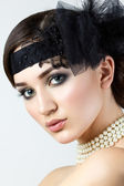 Close-up portrait of retro styled woman with pearl necklace — Foto Stock
