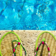 Two flip flops on the platform beside swimming pool — Stock Photo