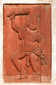 Red relief of man with club and rope (Bhaktapur, Nepal) — Stock Photo