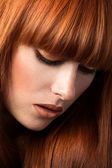 Red haired girl looking down portrait — Foto Stock