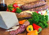 Cheese, wine, peppers, and dried Italian sausage — Stok fotoğraf