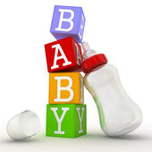 Baby concept of cubes with feeding bottle — Stock Photo