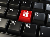 Computer keyboard with gift key - business background — Stock Photo