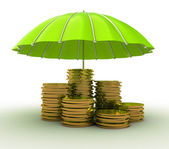 Stacks of golden coins covered by green umbrella isolated on white background — Stock Photo