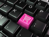 Shopping cart symbol at the computer key — Stock Photo