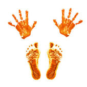 Prints of children's painted hands and feet. — Stock Photo