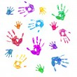Colorful background from prints of painted hands of family — Stock Photo
