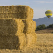Stock Photo: Air balloon and straw bales