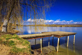 Fishing pier at the lake — Stock Photo