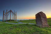 Standing stone and sunset in Transylvania,Romania — Stock Photo