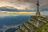 Beautiful sunrise in the mountains and Caraiman Heroes Cross Monument in Bucegi mountains,Carpathians,Romania — Stock Photo