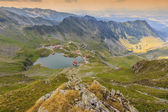 Alpine lake and curved road in mountains,Transfagarasan,Fagaras mountains,Carpathians,Romania — Stock Photo