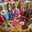 Stock Photo: Beautiful traditional handmade dolls and colorful dresses