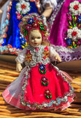 Beautiful traditional handmade doll and colorful skirt — Stock Photo
