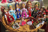 Beautiful traditional handmade dolls and colorful dresses — Stock Photo