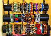 Exotic and loom bracelets on a stand — Stock Photo