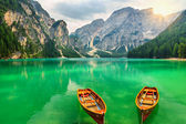 Wonderful mountain lake and boats in the Dolomites,South Tyrol,Italy — Stock Photo
