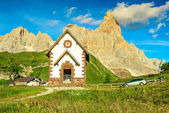 Tirolian chapel,car and high mountains,Dolomites,Italy,Europe — Stock Photo
