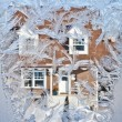 Stock Photo: Winter street through icy window...