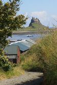 Low tide at Holy Island with Lindisfarne Castle in the background — Stock Photo