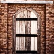 Stock Photo: Wooden vintage closed door with brick wall