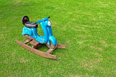 Toy Rocking Scooter on green grass — Stock Photo