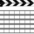 Clapper board on white background with films. — Stock Photo