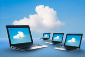 Laptop access to the clouds system — Stock Photo