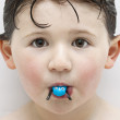Stock Photo: Boy in Tub Playing with Toy Frog