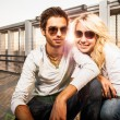 Amorous couple at sunset on a garage — Stock Photo