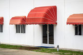 Red awning — Stock Photo