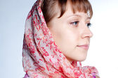 Modest young girl in head scarf — Stock Photo