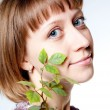 Royalty-Free Stock Photo: Young girl with a plant in the face