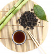 Stock Photo: Tea set and a branch of bamboo