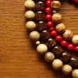 Necklace and beads on a wooden background — Stock Photo