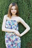 Girl posing near a tree — Stock Photo