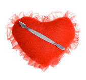 Shovel for manicure and a pedicure on a plush heart — Stock Photo