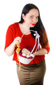 Portrait of beautiful female holding basket with Easter eggs isolated on white background — Stock Photo