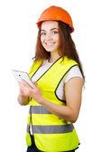 A garota o Construtor em um capacete e um colete com um tablet eletrônico nas mãos. está isolado. fundo branco. — Fotografia Stock