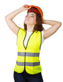 Girl wears a vest builder helmet on his head. Isolated.  — 图库照片
