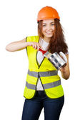 Girl in a helmet and vest holding a brush and a metal can of paint. — Stock Photo