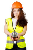 Girl in a helmet and vest holding a metal can. — ストック写真