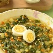 Royalty-Free Stock Photo: Vegetable soup with young nettles and eggs