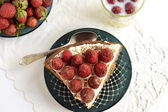 Slices of pie with strawberries and milk, top view — Stock Photo