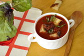 Cold tomato soup with croutons and sun-dried tomatoes — Stock Photo