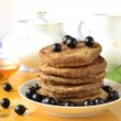 Stock Photo: Stack of pancakes with fresh black currants